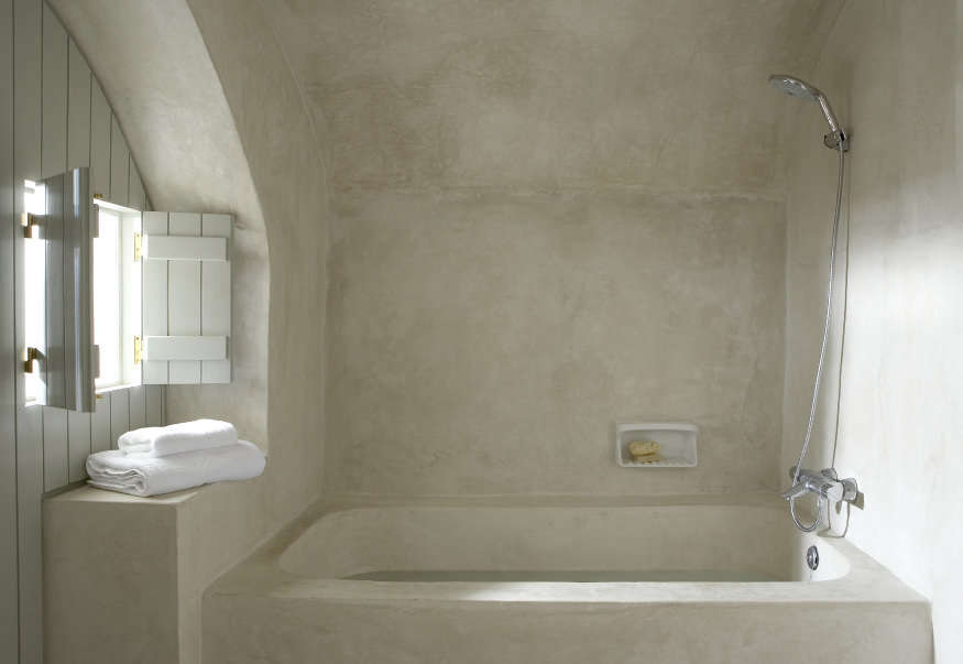 A tadelakt bath, as seen in Villa Fabrica: Serenity in Santorini.