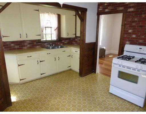 The Before view shows the original orientation of the kitchen. The stove and wall occupy the space where the open counter now stands.