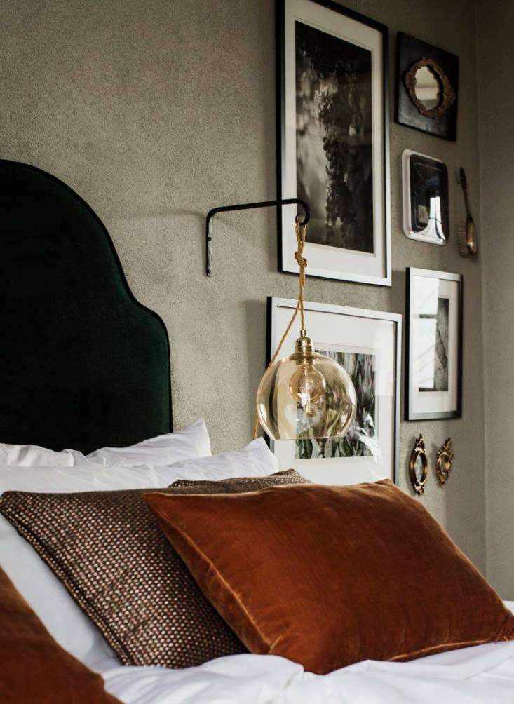A detail of the Bolon-designed woven cushions. On the wall: vintage black-and-white photographs and tiny antique mirrors.