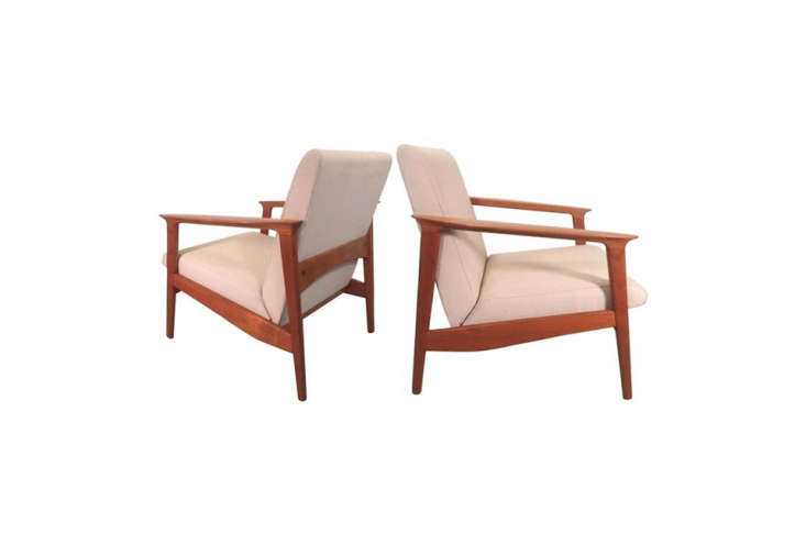 Jones found their Danish armchairs at Brimfield and had them reupholstered (see upholstery fabric below for the source). For something similar, source chairs like this Set of Vintage Danish Teak Armchairs for $