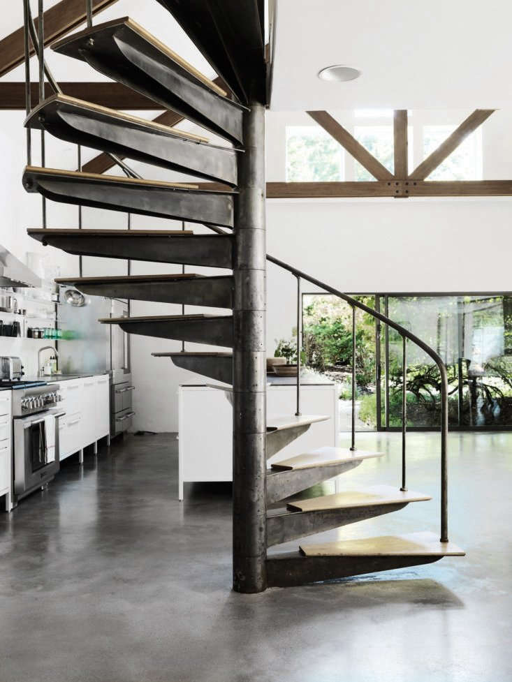 Kitchen of the Week A Vipp Modular Kitchen in the Hamptons The kitchen is in a new extension of the house that leads to an outdoor patio. The steel spiral stair, polished concrete floor, and barn style joists stand out against bright white walls.