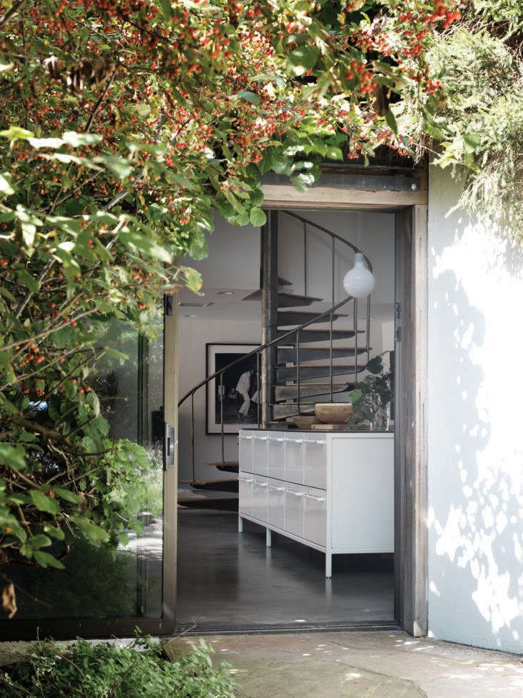 Kitchen of the Week A Vipp Modular Kitchen in the Hamptons A foliage framed sliding glass main entrance opens to an expansive kitchen living room in a converted potato barn used as a country house.