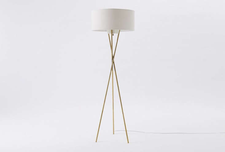The Midcentury Tripod Floor Lamp in brass is $9 from West Elm.