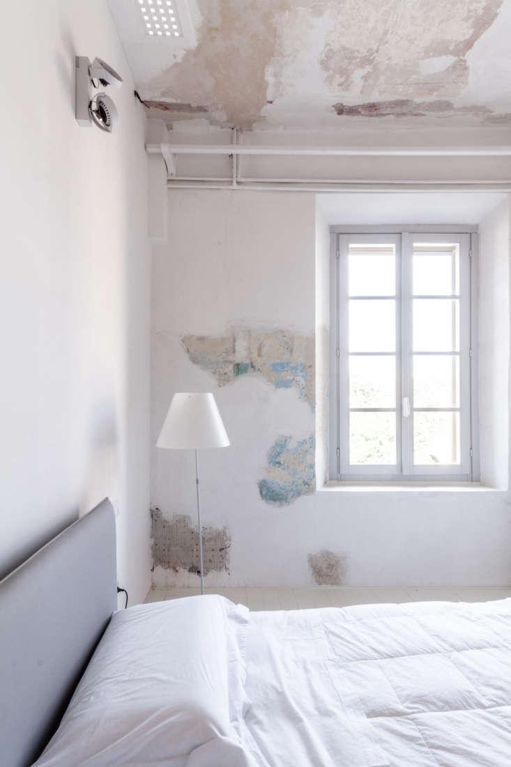 white bedroom aged scraped plaster wallpaper walls archiplan studio