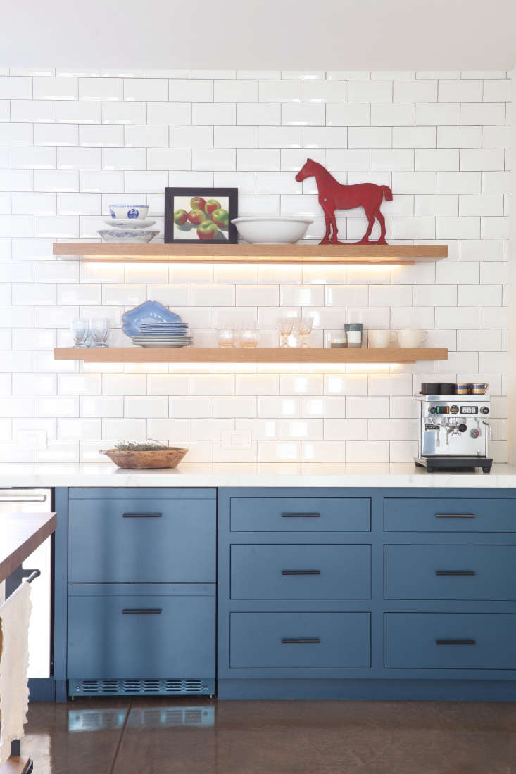 white tile backsplash kitchen led lighting open wood shelves blue cabinets