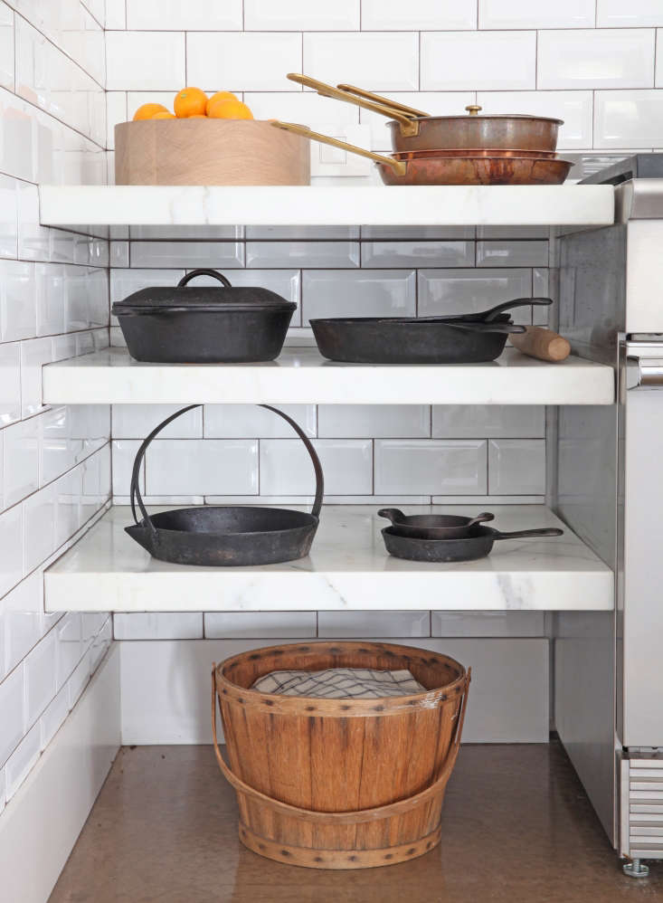Next to range, marbleshelves are inserted into a tiled niche; it&#8