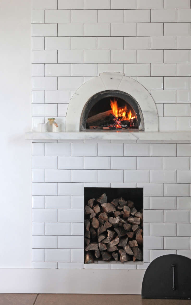 The pizza oven is fromWildwood Ovensin Los Angeles, and the marble surround with keystone detail was designed by Belinda.