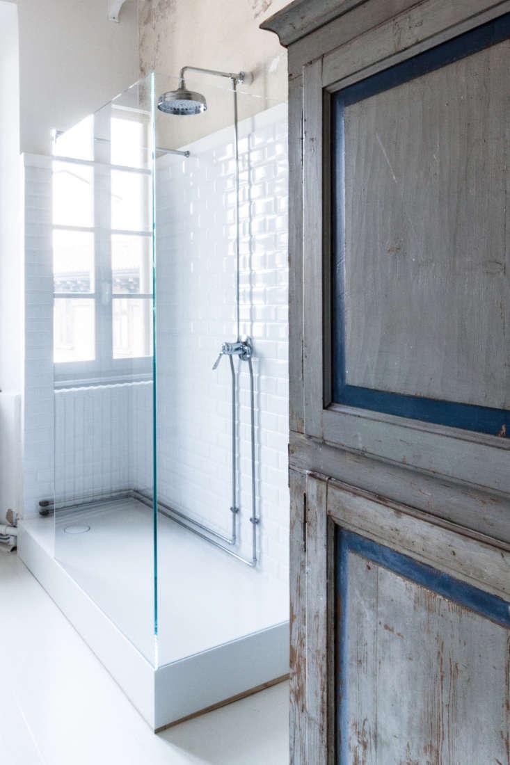 white tile shower antique blue gray armoire archiplan studio