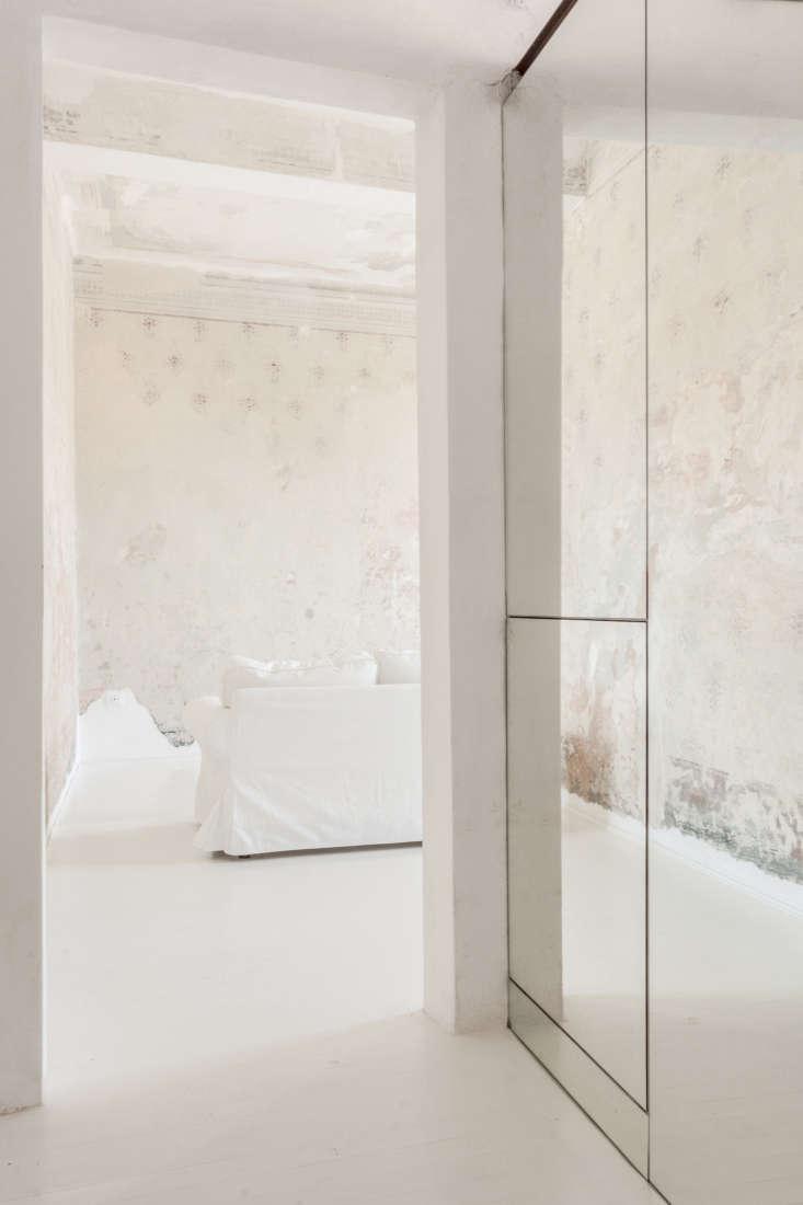 white walls sofa mirror closet archiplan studio