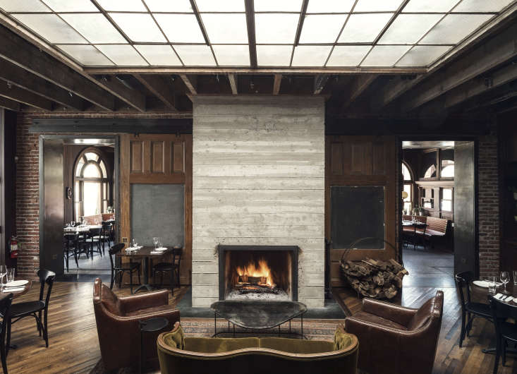 Like the hotel, the restaurant, which includes a fireside lounge, marries old-world and industrial textures—wood, concrete, leather, and steel—to conjure a modern pub feel.