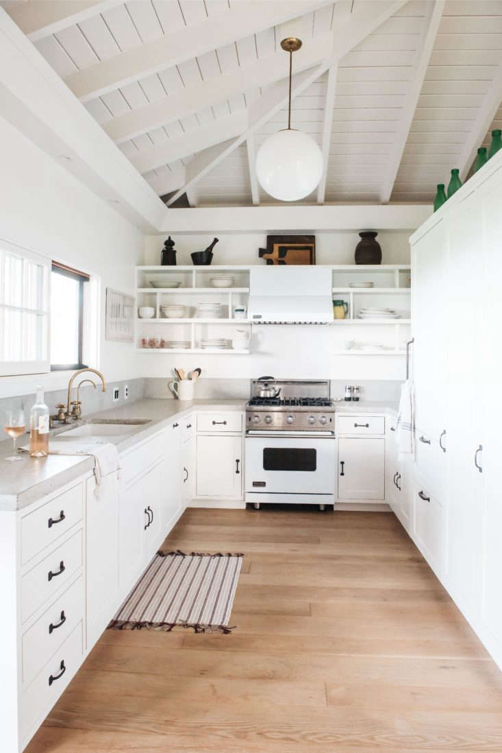 In the retro-modern kitchen of a beach cottage in Hawaii, New York–based architect Roberto Sosa opted for a poured-in-place concrete countertop (and backsplash). For more of this kitchen, see Steal This Look: A Modern, All-White Kitchen in Maui.