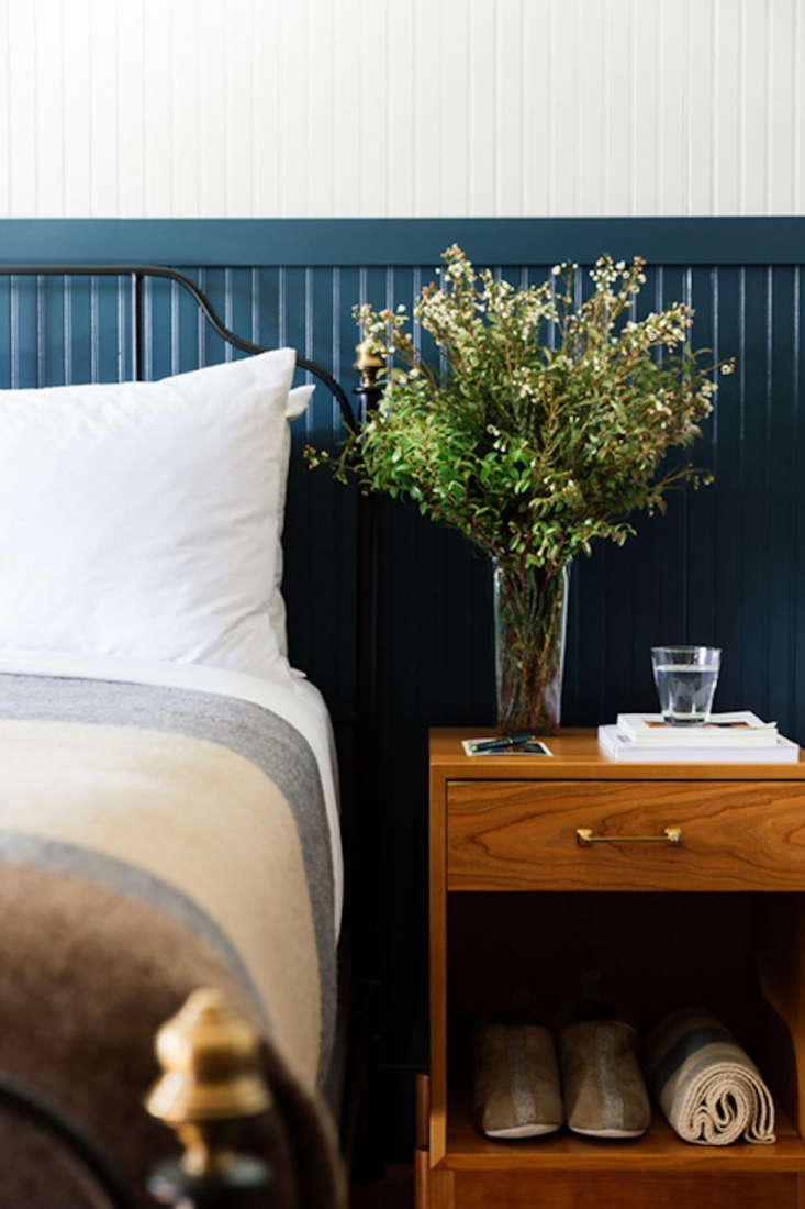 Go West A Mountain Lodge in Jackson WY by a Brooklyn Design Studio Tucked beneath a nightstand byHedge House: slippers byShepherd of Sweden via Westerlind (available for purchase in the lobby shop). (See alsoOut Like a Lamb: Scandi Sheepskins from Shepherd of Sweden.)