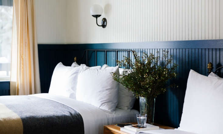 Go West A Mountain Lodge in Jackson WY by a Brooklyn Design Studio The two toned beadboard walls add a warm yet masculine feel to the rooms. By the beds:fresh cut mountain wildflowers.