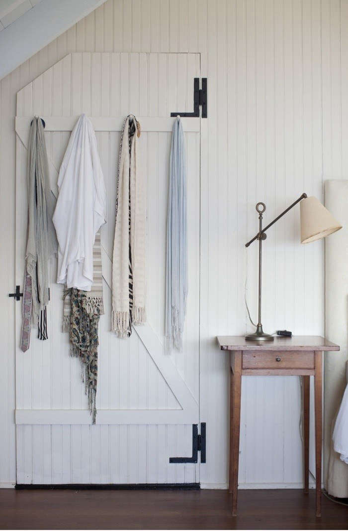 In their home inLittle Compton, Rhode Island, Dara and Dan Brewster ofDara Artisansemployed a combination of beadboard and Shaker hooksin their master bedroom. SeeThe Brewsters at Home in Little Compton, RI.Photography by Nathan Fried Lipski ofNate Photography.