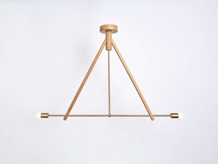 TheLodge Chandelier Two has a frame of both oak wood and solid brass; $loading=