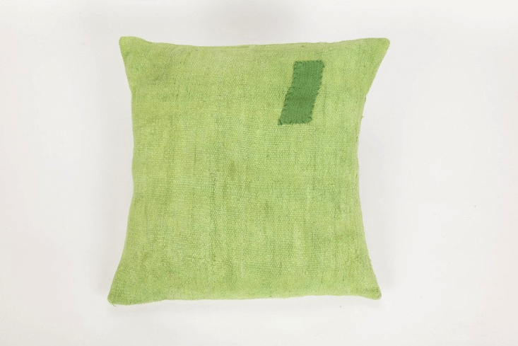 The Coté Pierre Overdyed French Pillow in light green is $5.