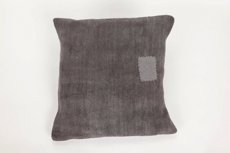 The Coté Pierre Overdyed French Pillow in indigo is $5.