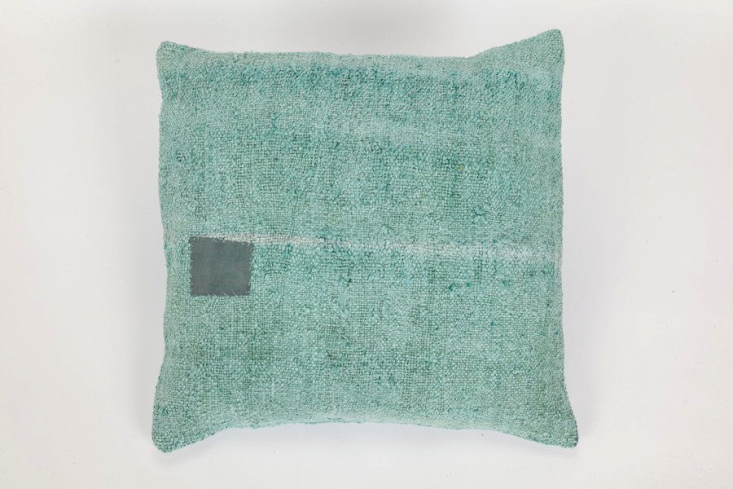 The Coté Pierre Overdyed French Pillow in turquoise is $5.