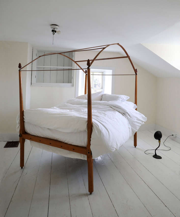 a vintage canopy bed, lamp, and chair comprise the onlyfurniture in deborah&a 25