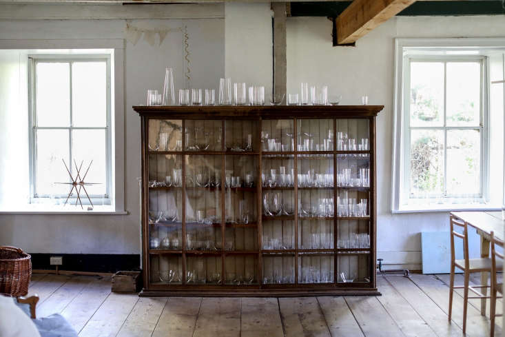 a vintage cabinet showcases deborah&#8\2\17;s crystal pieces, which are han 10
