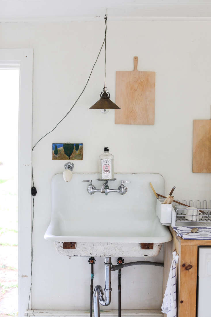 a vintage utility sink adds to the workshop feel of the kitchen.photograph by 12