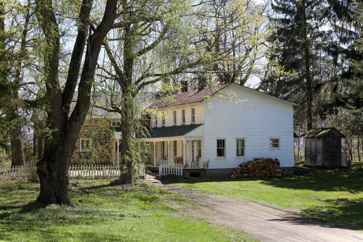 the farmhouse was later expandedwith a clapboard addition. 30