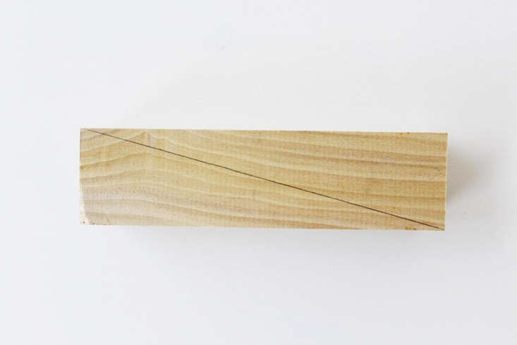 step \1: marka diagonal line across the lengthof your wood, and saw in half 11