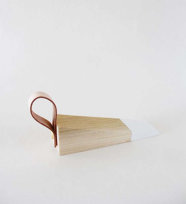 the finished doorstop has a painted tip andan easy to grab leather tail. 9