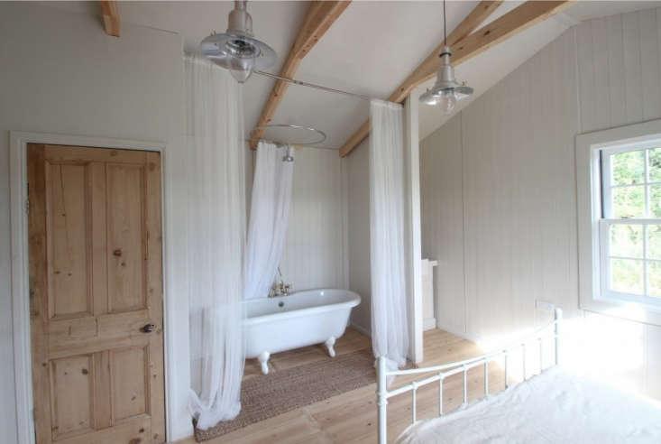 gauzy curtains surround anen suite claw foot bathtub. 13