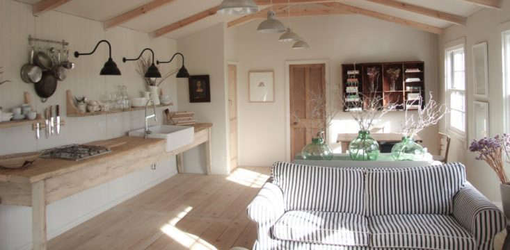 the living area includes a simple workbench kitchen. 9