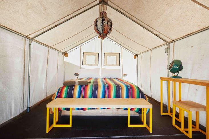 At El Cosmico in Marfa, Texas, hotelier Liz Lambert mixes South American, Moroccan, and midcentury pieces in her canvas frame tents. Photograph by Nick Simonite.
