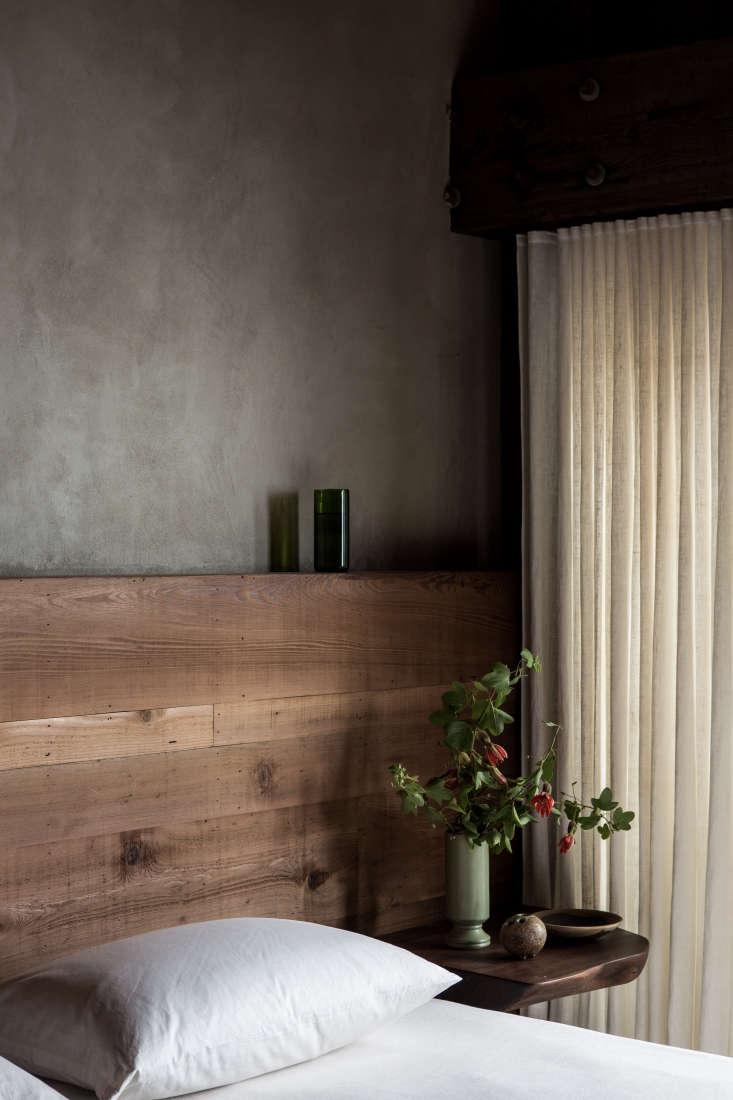 bedroom curtains are simple white linen. walls are finished innatural earth p 14