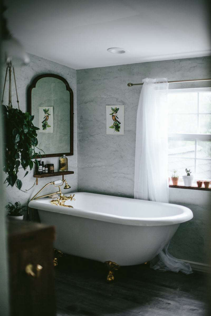 The bath in a sea foam hue by Master of Plaster.