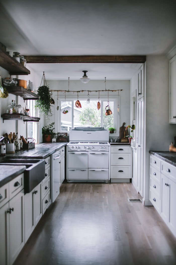In remodeling her Portland, Oregon, kitchen, blogger Eva Kosmas Floresfound a vintage 50s Roper gas range on Craigslist for $375, and had the kitchen reconfigured with a gas line. Read more atA Food Blogger's Rustic DIY Renovation in Portland, OR, Dark and Moody Edition.
