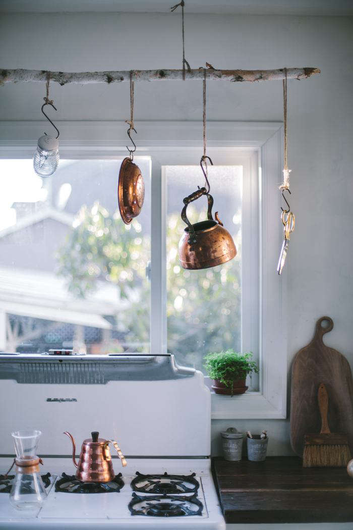 Portland-based blogger Eva Kosmas Flores repurposed a branch from a dead birch tree in her yard into a simple pot rack that suits the moody interiors. See more inA Food Blogger's Rustic DIY Renovation in Portland, OR, Dark and Moody Edition.