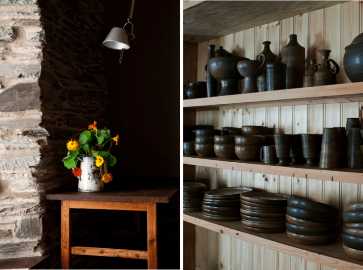 Above, L to R: Nasturtiums in a vintage coffee pot illuminate a dark nook. In the dining area, handmade, local ceramics collected over the years by Sian and James are displayed on open shelves.