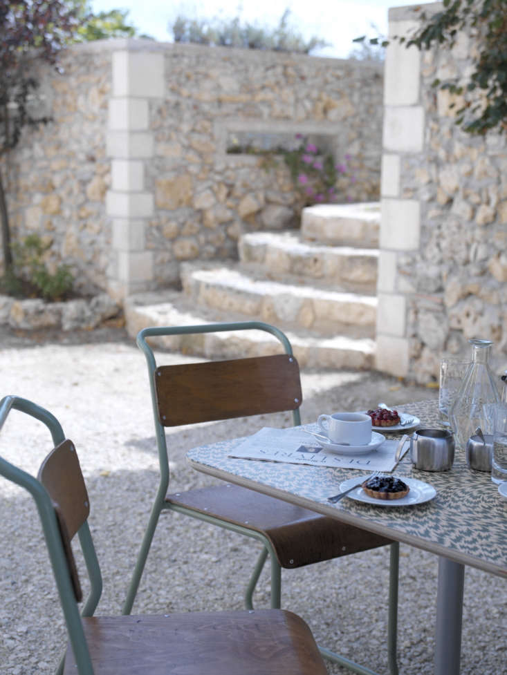 Outdoor breakfast table at t Hautfage House, Studio Maclean's restored and remodeled farmhouse in South West France available for rent