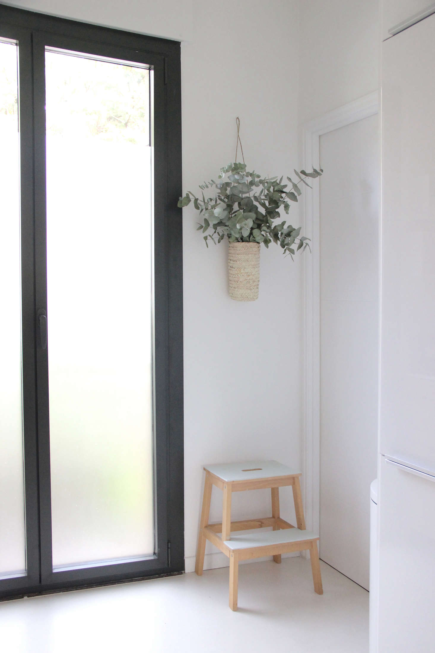 Slim, aluminum-framed glass doors fit in even the tightest of spaces, as seen at one end of a narrow kitchen; seeKitchen of the Week: A Designer's Own Ikea Hack Kitchen in Provence, Before and After.