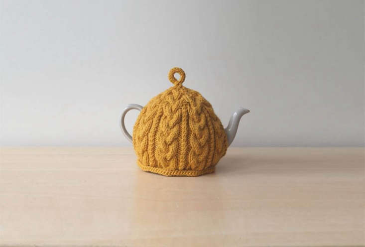 a golden yellow knitted tea cosy is available from lindy knits, a seller on ets 22