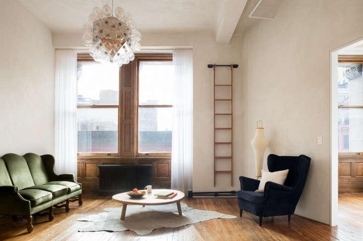 living room bubble chandelier wood floors hide rug