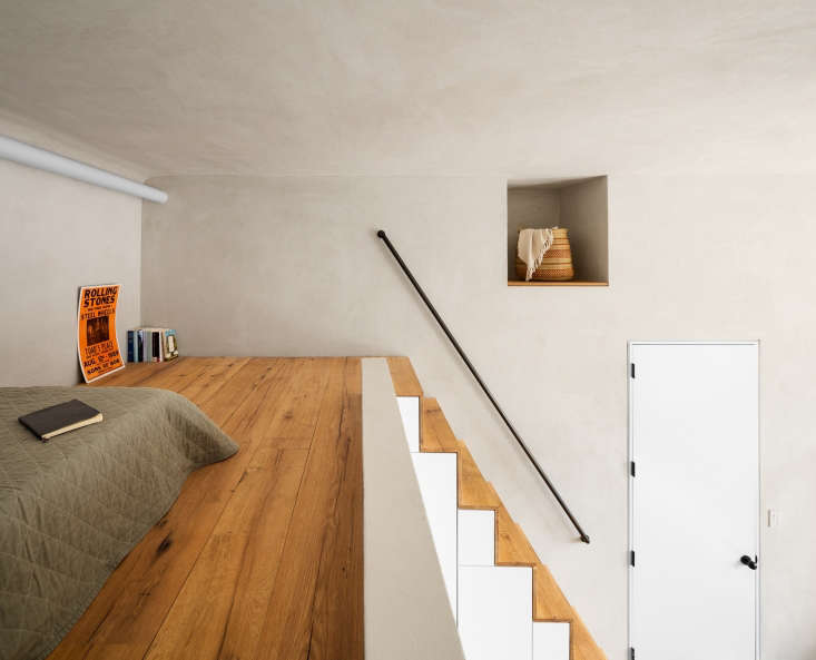 lofted sleeping space in nyc loft apartment plaster walls 1