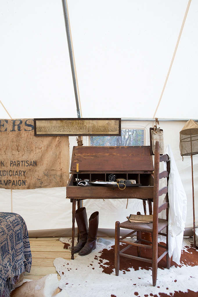 hermant andstanley outfitted the tent with an antique writing desk, ladder ba 11