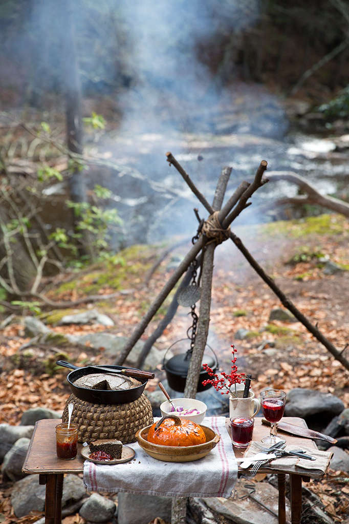 creature comforts include a folding wood table, cast iron skillet, casserole  15
