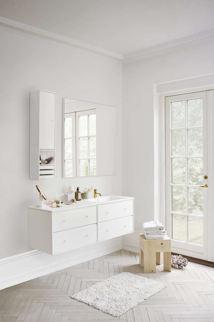 A double drawer unit with sink in a spacious bathroom. The wall-hung storage modules (shown next to the mirror) come in a variety of sizes and offer the option of doors, drawers, or open shelves.