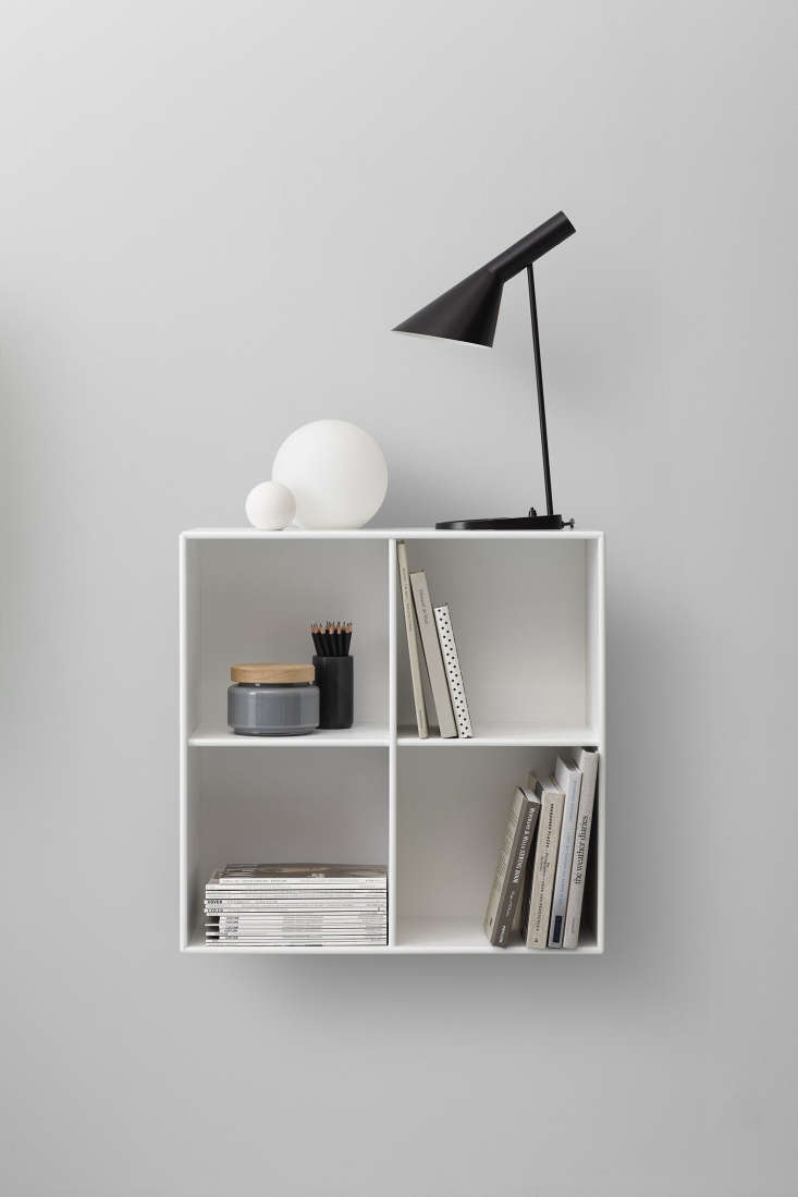 A divided cube is ideal for storing magazines, books, and small accessories.