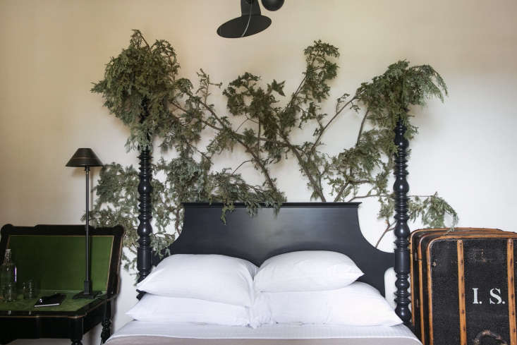 A Northern California Roadhouse Inn Restored with Whimsy and a Hint of Surrealism Foraged branches are tucked behind the bed frame (the hotel's foraged decor changes often). Tucked under pillows are eye masks and earplugs in glassine bags.