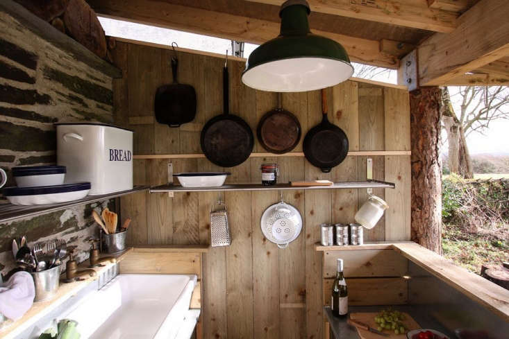 Another rustic arrangement: A no-frills kitchen at the Fforest camp in Wales faces the outdoors and includes a selection of cast-iron pans. See Glamping Roundup: loading=