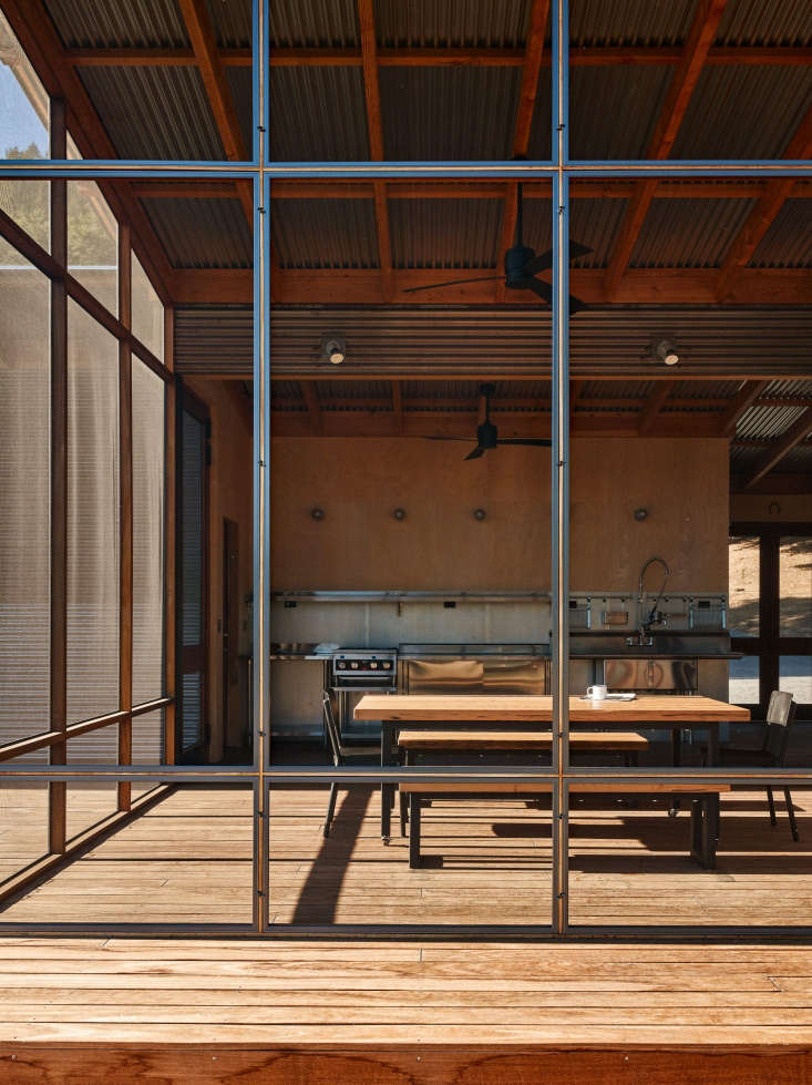 outdoor covered screened dining porch kitchen corrugated roof
