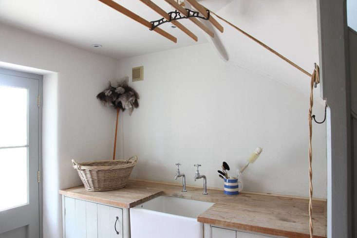 a simple utility sink anchors one end ofthe laundry room. photograph courtesy 9