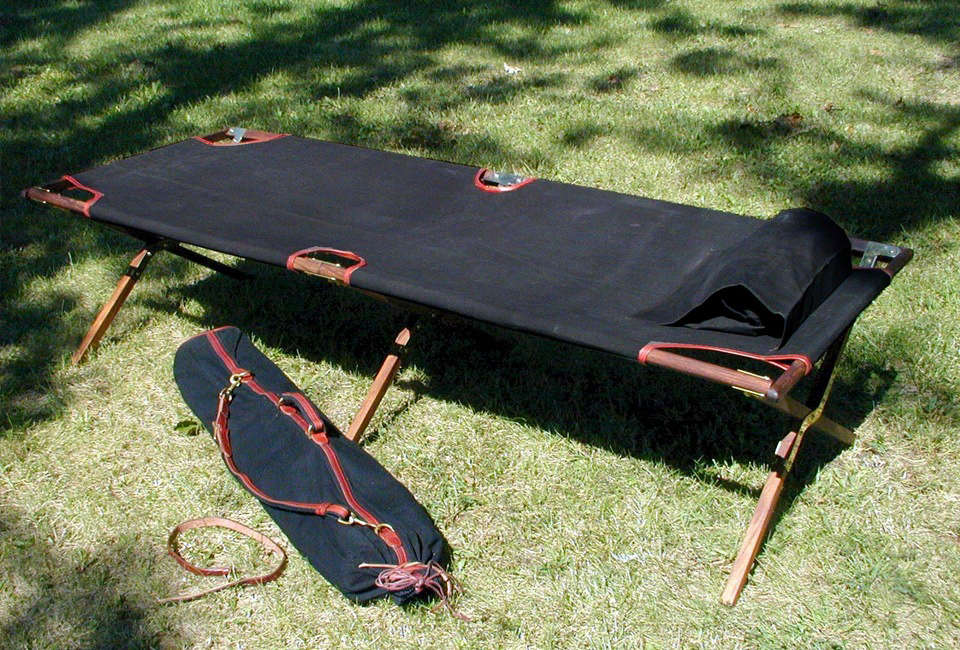 A reproduction of the classic British army cot in sophisticated, leather-trimmed black canvas, Peter Hofer Jagdwaffen&#8